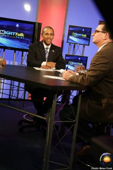 "Hosts Lenny McAllister (""NightTalk: Get to the Point"") and Ellis Cannon (""NightTalk"") prepare for another segment in the conversation for the year-end special on ""NightTalk: Get to the Point"" (December 19, 2014)"