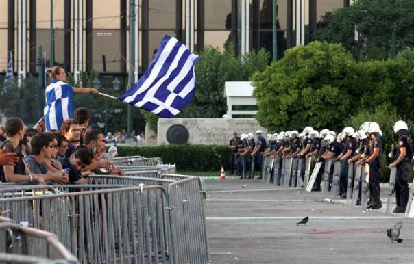 Greeks protest over the proposed new rounds of austerity to deal with the Greece economic crisis and bailout.