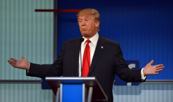 Donald Trump shrugs as he maintains a lead in the polls after the August 6 debate in Cleveland.